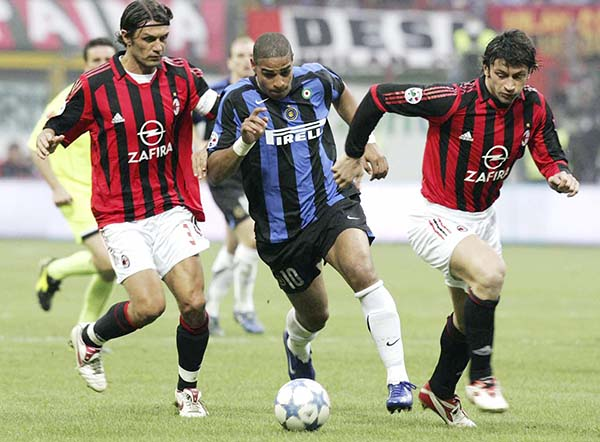 MILAN, ITALY - APRIL 14: Paolo Maldini and Kakha Kaladze of AC Milan challenge Adriano of Inter during the Serie A match between AC Milan and Inter Milan at the San Siro on April 14, 2006 in Milan, Italy. AC won the match 1-0. (Photo by Newpress/Getty Images) *** Local Caption *** Kakha Kaladze;Paolo Maldini;Adriano
